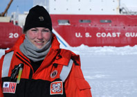 Frey in front of U.S. Coast Card icebreaker