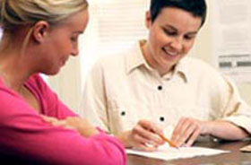 student with writing consultant