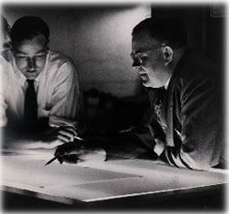 Guy H. Burnham working with a student